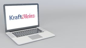 Opening and closing laptop with Kraft Heinz logo. 4K editorial 3D rendering Stock Photography