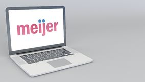 Opening and closing laptop with Meijer logo. 4K editorial 3D rendering Royalty Free Stock Photo