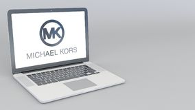 Opening and closing laptop with Michael Kors logo. 4K editorial 3D rendering. Opening and closing laptop with Michael Kors logo. 4K editorial 3D Stock Photo
