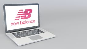 Opening and closing laptop with New Balance logo. 4K editorial 3D rendering. Opening and closing laptop with New Balance logo. 4K editorial 3D Royalty Free Stock Images