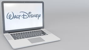 Opening and closing laptop with Walt Disney Pictures logo on the screen. Computer technology conceptual editorial 4K
