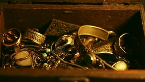 Opening and closing the treasure chest. Night scene. Close-up of Opening and closing the treasure chest stock footage