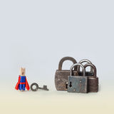 Opening concept photo. Locked padlock. Superhero opener character in blue, red suit with key and metal lock on gradient. Background royalty free stock photos