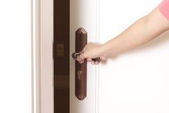 Opening the door. With hand on the doorknob Stock Photos