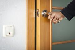 Opening door. The person opens an interroom door Royalty Free Stock Images