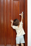 Opening the door. A cute chinese baby is opening the door in home Royalty Free Stock Photos