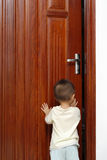 Opening the door. A cute chinese baby is opening the door in home Royalty Free Stock Photography