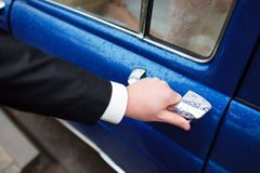 Opening the door of the car Royalty Free Stock Photo