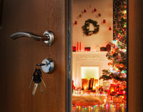 Opening door in christmas room, welcome to holiday stock image