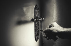 Opening The Door. Conceptual composition about safeness, that very moment of opening the door Stock Photos
