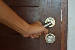 Opening door knob Royalty Free Stock Image