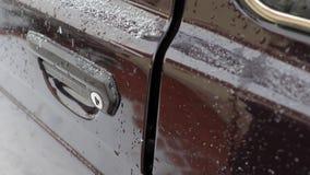 Car door opening. Opening the door of an old car in snowy weather stock footage