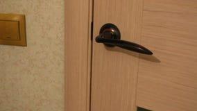 Opening the door. The door opens . Turn the door knob stock video footage
