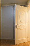 The opening door of a room Stock Photography