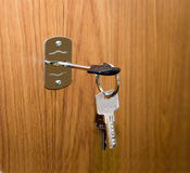 Opening of doors by means of keys Royalty Free Stock Photo