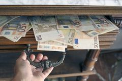 Opening a drawer full of  fifty euro notes Stock Image
