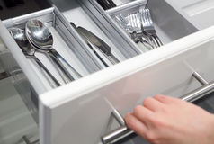 Opening drawer for Silver cutlery Royalty Free Stock Photo