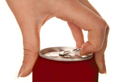 Opening a drink. Hand of a woman opening a soda can Royalty Free Stock Photos