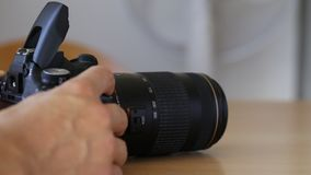 Opening and flashing the built-in flash with lens. Photographing stock video footage