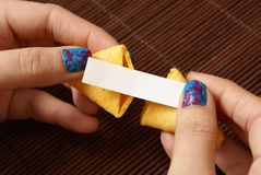 Opening A Fortune Cookie Stock Image
