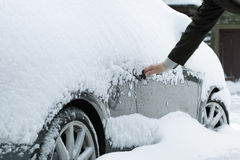 Opening a frozen car door Royalty Free Stock Photo
