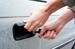 Opening frozen car lock Royalty Free Stock Image