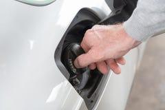 Opening fuel tank cap Royalty Free Stock Photo