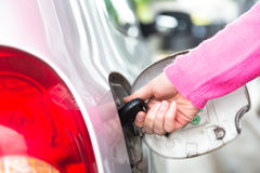 Opening the fuel tank with a key Royalty Free Stock Photo
