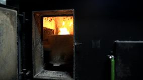 Opening the furnace. Using a big concrete furnace stock video