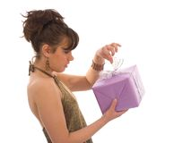 Opening a gift. Surprised woman opening a purple gift box Royalty Free Stock Photo