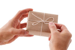 Opening a gift box. Opening a brown recycled paper gift box Stock Photo