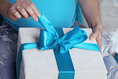 Opening gift boxes with blue bows Royalty Free Stock Photos