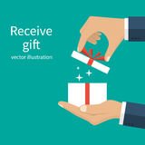 Opening gift in hand Royalty Free Stock Photography