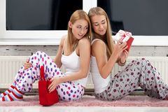Opening gifts. Two girls opening christmas gifts Royalty Free Stock Image