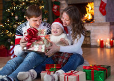 Opening gifts on Christmas and New Year Stock Image