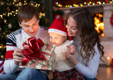 Opening gifts on Christmas and New Year Stock Photos