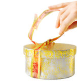 Opening a golden chirstmas box Stock Image