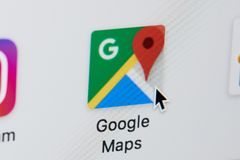 Opening google maps web page. New york, USA - March 8, 2018: Opening google maps web page on laptop screen close-up. Cursor on computer icon Stock Photography