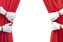 Opening. Hands opening red curtain on white Stock Images