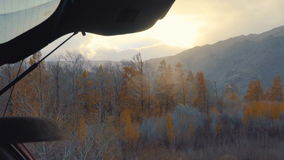 The opening of the high mountains of Altai and the sun`s rays in winter or autumn. Next to the car SUV, the back door opened. The idea of travel and adventure stock footage