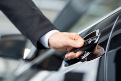 Opening his new car. royalty free stock images