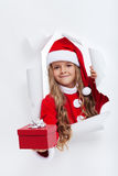Opening the holidays season - little girl offering you a present Stock Photography