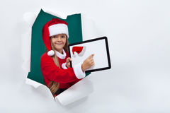 Opening the holidays season online - little girl with tablet com Royalty Free Stock Photo