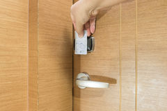 Opening a hotel door with keyless entry card Stock Images