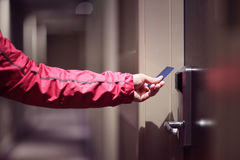 Opening hotel door with keyless entry card stock photos