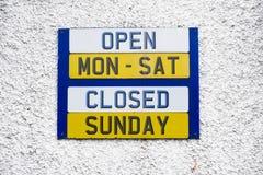 Opening hours shop sign Monday to Friday daytime closed Sunday royalty free stock image