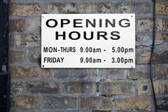 Opening hours shop sign Monday to Friday daytime stock images