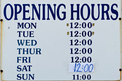 Opening hours sign. Old grunge opening hours sign Royalty Free Stock Photo
