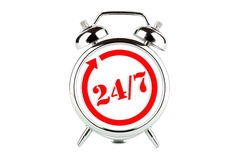 Opening hours sign. On the alarm clock - 24 hours 7 day royalty free stock photography