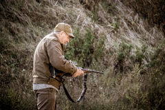 Opening of the hunting season. An elderly hunter Stock Photos
